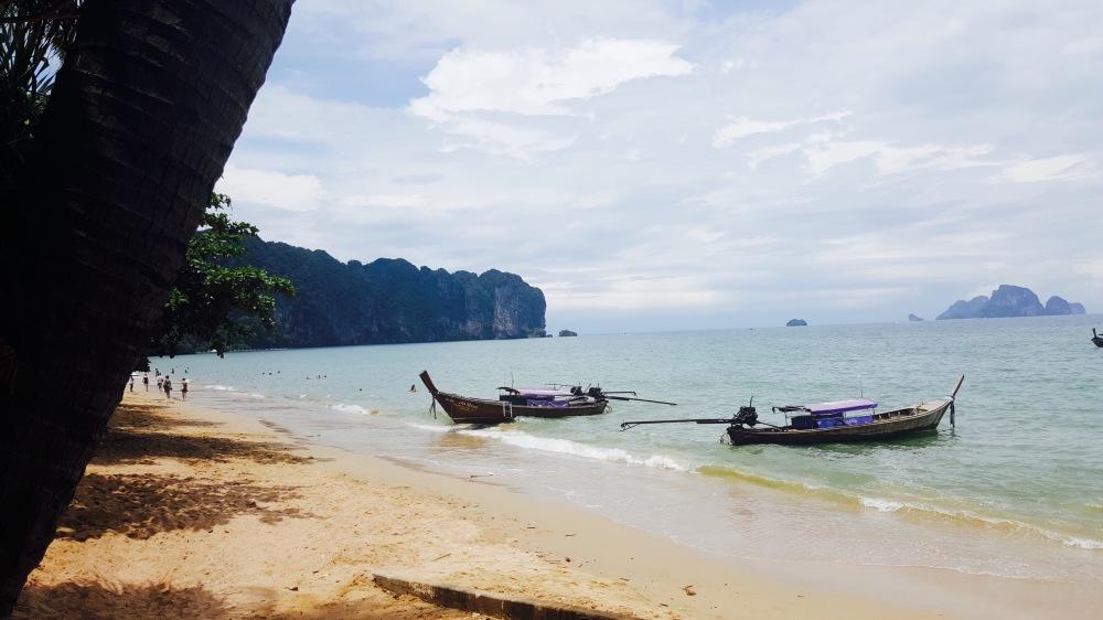 longtail boat docked at ao nang seaside